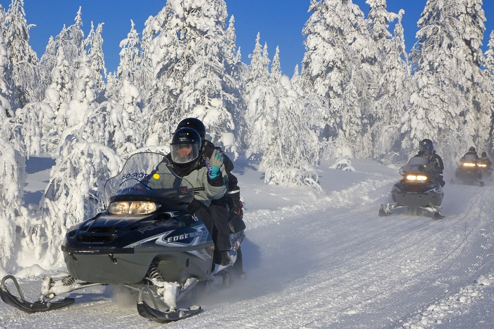 Driving Snowmobile in Lapland